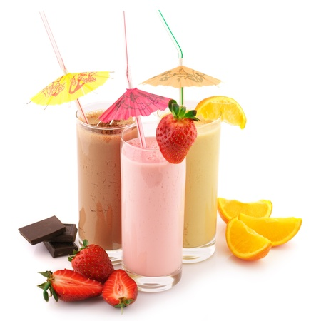 fruit shake: Three assorted protein cocktails with straws, decorations and fruits isolated on white background.