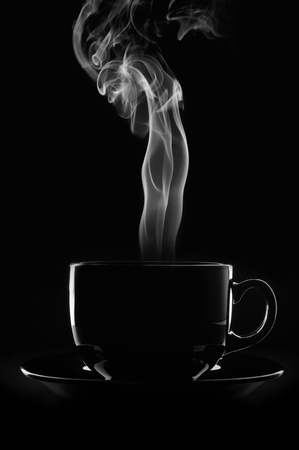Black cup of coffee with steam on black background. Stock Photo - 9238556