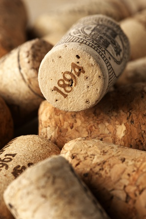 wineries: Heap of used vintage wine corks close-up.