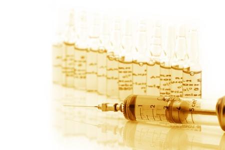 Ampules and syringe on white background. Toned monochrome image. photo