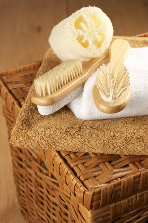 Various SPA accessories on wicker basket. photo