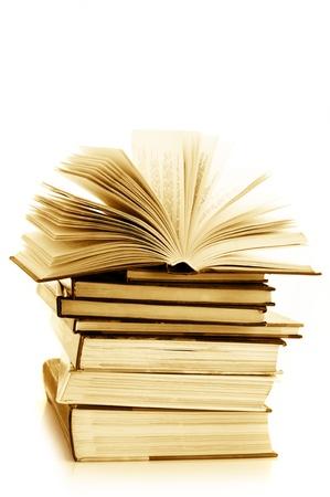 writing book: Pila di libri vari isolati su sfondo bianco. Immagine tonica.