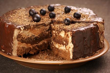 Homemade chocolate cake on brown canvas. photo