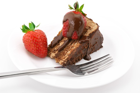layer cake: Slice of chocolate cake with strawberries and fork in white plate on white background.