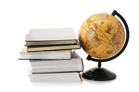 Vintage globe and stack of books isolated on white background. photo