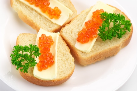 Close-up of canapes with butter and salmon caviar. photo