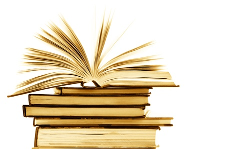 expertise: Stack of opened and closed books on white background. Toned image.