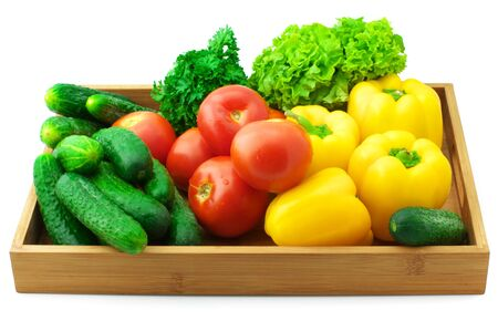 Various fresh vegetables in wooden tray isolated on white background.. photo
