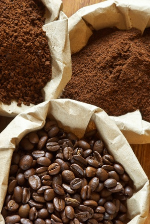 coffee grounds: Close-up of assorted coffee in paper bags.