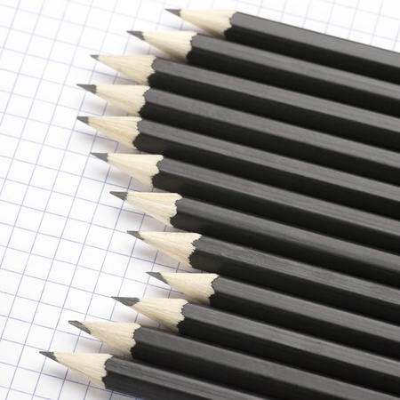 Set of black pencils on checked page. Stock Photo - 9524740