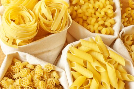 Close-up of assorted pasta in jute bags. photo
