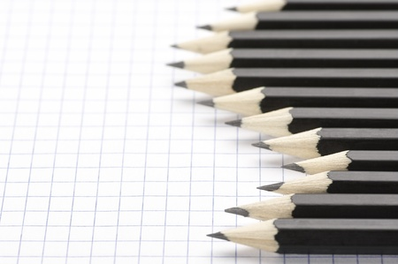 Set of black pencils on checked page. Stock Photo - 9569308