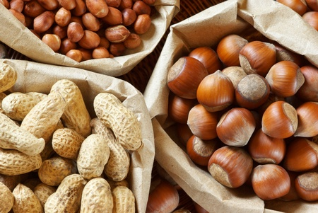 Close-up of assorted nuts in paper bags. Stock Photo - 9569348