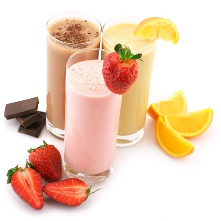 fruit shake: Three assorted protein cocktails with fruits isolated on white background.