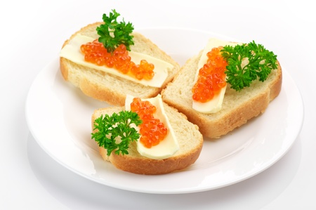 Canapes with butter and salmon caviar. photo