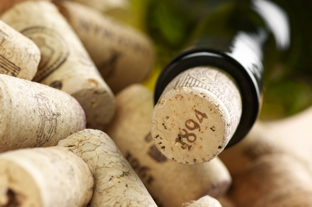 closed corks: Close-up of closed wine bottle and heap of used. Stock Photo