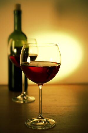 Two glasses of red wine and wine bottle. Stock Photo