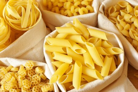 Close-up of assorted pasta in jute bags. Stock Photo - 9694283