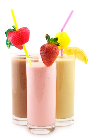 Three assorted protein cocktails with straws and decorations isolated on white background. photo