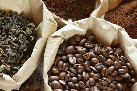 coffee and tea: Close-up of assorted coffee and green tea in paper bags.