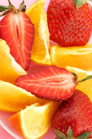 Mix of strawberry and citrus slices close-up. photo