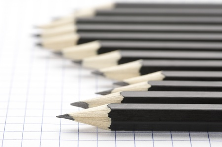 Set of black pencils on checked page. Stock Photo - 9824881