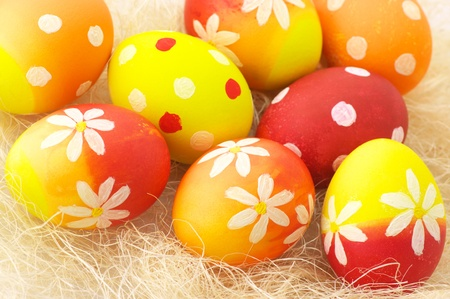 haulm: Close-up of yellow, orange and red Easter eggs in haulm.