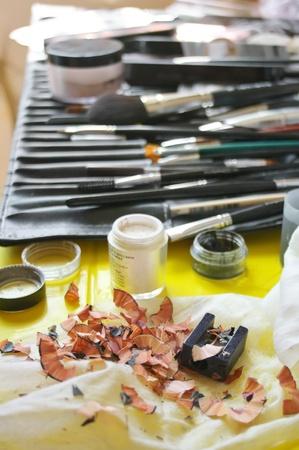 visagiste: Set of professional make-up accessories on visagiste working place. Selective focus on foreground (shaving).