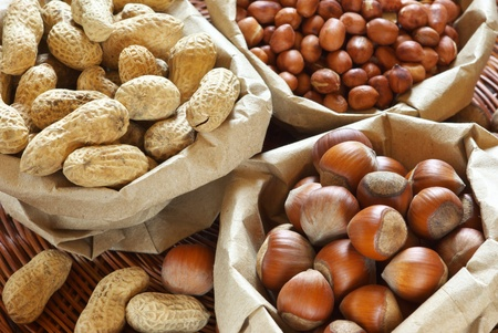 health food store: Close-up of assorted nuts in paper bags.