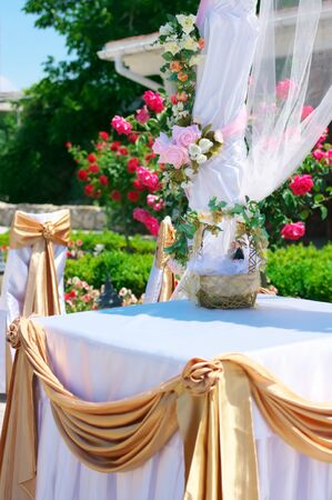 Decorations at outdoor wedding reception. photo