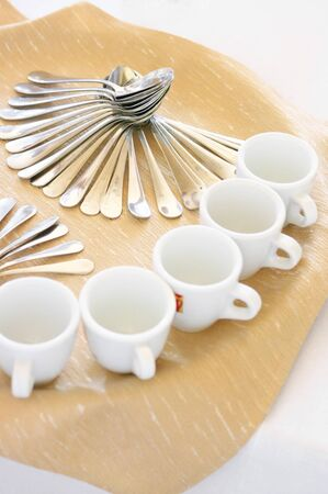 Set of spoons and cups on party table. photo