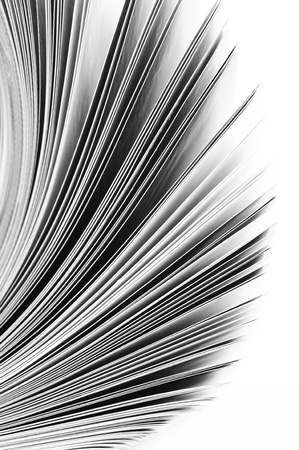 Close-up of magazine pages on white background. B&W image. Shallow DOF, focus on edges. photo