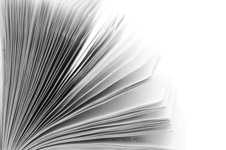 Close-up of open book on white background. B&W image. Stock Photo - 10418520