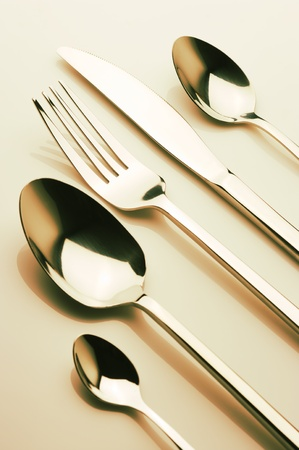 Set of steel fork, knife and spoons. Toned image. Stock Photo