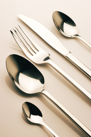 Set of steel fork, knife and spoons. Toned image. Stock Photo - 11306487