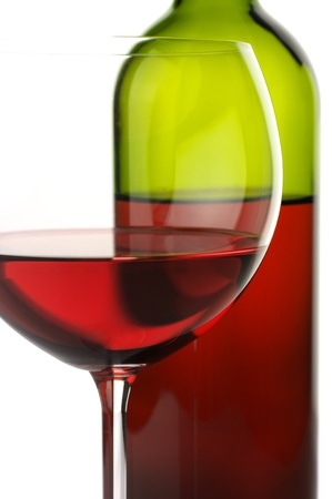 Close-up of glass and bottle of red wine on white background. Stock Photo - 11306486