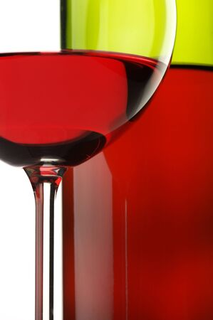 Close-up of glass and bottle of red wine on white background. Stock Photo - 11743809