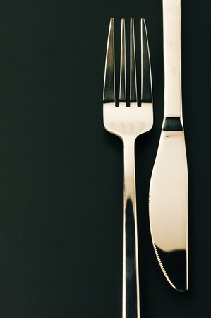 Close-up of fork and knife on dark background with copy space. Stock Photo - 11890680