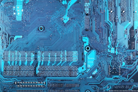 Computer part: downside of circuit board close-up. photo