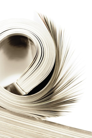 editorial: Close-up of rolled magazine on white background. Toned image.