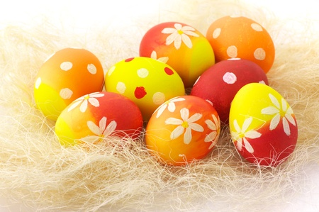 haulm: Yellow, orange and red Easter eggs in haulm.