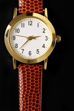 Classical wrist watch on black background. photo