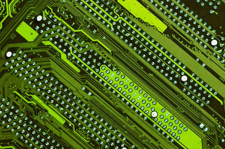 microelectronics: Computer part: downside of circuit board close-up. Stock Photo