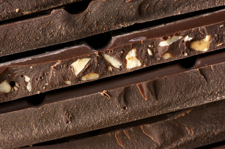 Close-up of stacked assorted dark chocolate. photo
