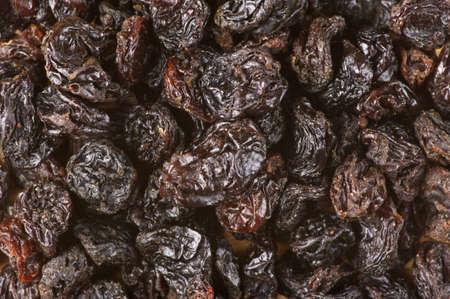 Close-up of dark raisins (currant). Top view point. photo