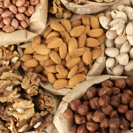 Close-up of assorted nuts in paper bags. Top view point. photo