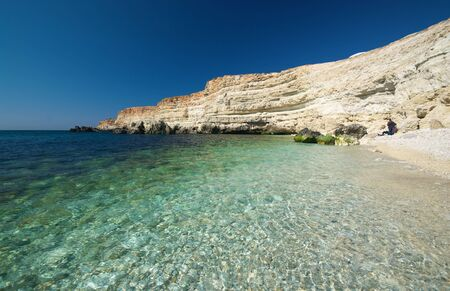 calcareous: Sea, pebbly beach and calcareous rock. Stock Photo