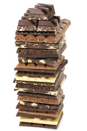 Stack of assorted chocolate isolated on white background. photo