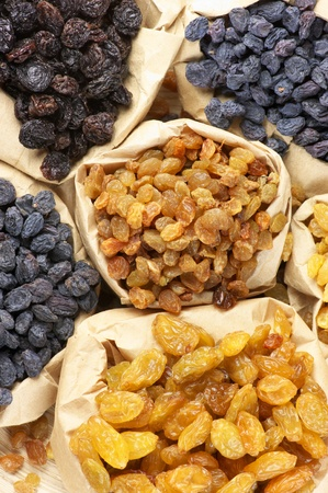 Various raisins in paper bags. Top view point. photo