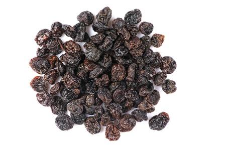 Pile of dark raisins isolated on white background. photo